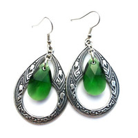 Sterling silver pendant, Sterling silver ear wire, and dark green Swarovski crystals earrings.