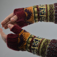 Beautiful handmade fingerless gloves knitted of wool with colorful ornaments
