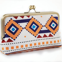 Tribal clutch with geometric shapes