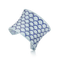 Tiffany & Co. - Cuff in 18k white gold with sapphires and diamonds.
