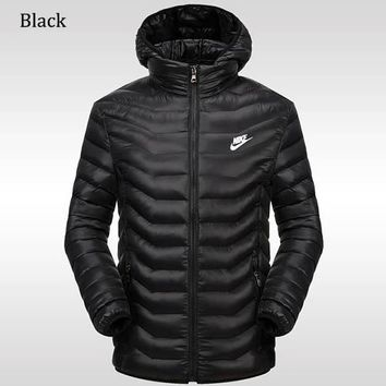 NIKE 2018 winter new sports and leisure detachable hat warm down cotton padded clothes black