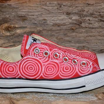 circles on red converse all star slip ons