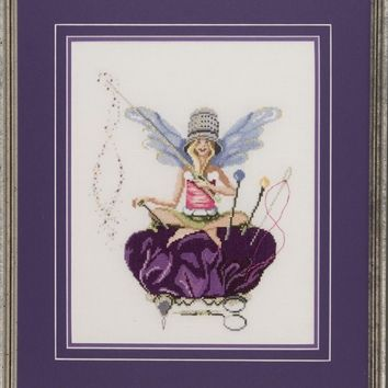 Thumbelina Sits Cross Legged on a Royal  Purple Pincushion