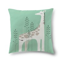 Sleeping giraffe with trees