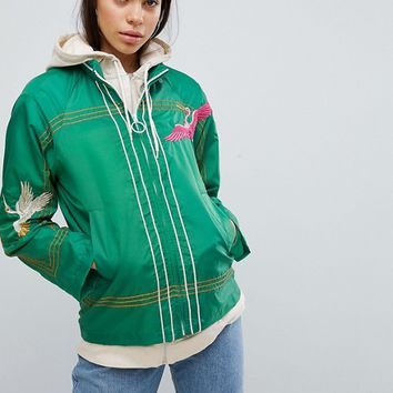 ASOS Embroidered Rain Jacket at asos.com