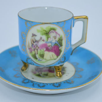 Andrea Sadek Blue Victorian Tea Cup & Saucer Vintage Footed Demitasse Cup Gilded Courting Couple Scene Hand Painted Made in Japan
