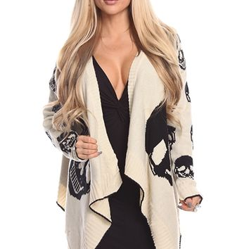 Featuring super soft cream knit sweater fabrication with big black color skull pattern at back panel & medium size black skull patter at both side of front panel, open front style, long sleeves with small black skulls patter throughout, and finish with asy