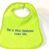 Beautifully embroidered bib for a baby boy