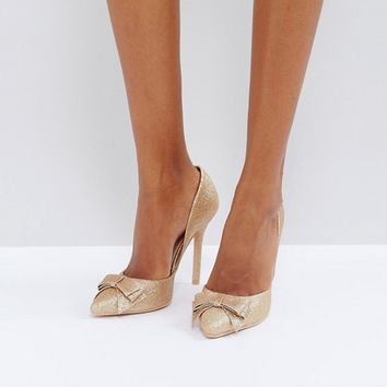 True Decadence Rose Gold Glitter Bow Detail Court Shoes at asos.com