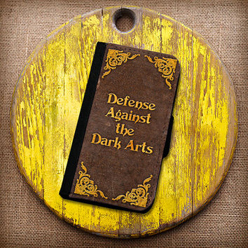 Harry Potter Inspired Defense Against The Dark Arts Wallet Case. Choose iPhone 4/4s, 5/5s, or 5c.