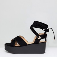 RAID Wide Fit Alma Black Flatform Ankle Tie Sandals at asos.com