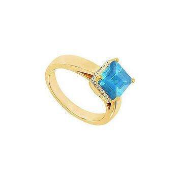 Blue Topaz and Diamond Ring : 14K Yellow Gold - 0.83 CT TGW