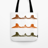 Monument Valley, 3 mountains, 3 colors Tote Bag by Claude Gariepy