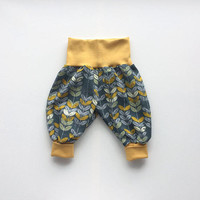 Baby pants with leaves. Baggy harem pants. Dark grey jersey knit fabric with yellow plants and leaves. Infant pants. Gender neutral