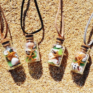 Small Glass Bottle Necklace filled with tiny seashell, sea glass,sand dollar and starfish.