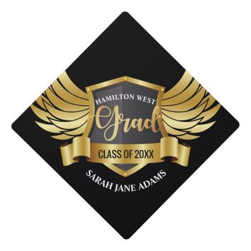 Golden eagle wings shield crest with ribbon text graduation cap topper