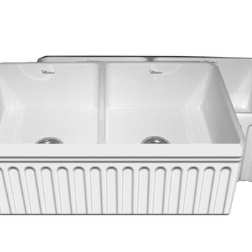 Quatro Alcove double bowl reversible fireclay sink with a fluted front apron and a decorative 2 ½ inch lip on one side and a fluted front apron on the opposite side