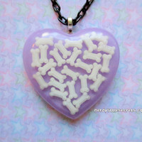 Pastel Creepy Cute Bone Heart Necklace by NerdyLittleSecrets