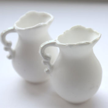 Mini jug made from pure white fine bone china and mother of pearl rim and handle in stoneware