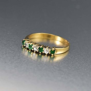 English Estate White Topaz and Emerald Eternity Ring