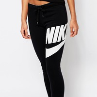 Nike Rally Skinny Cuffed Sweat Pants With Logo Waist Band & Large Front Logo