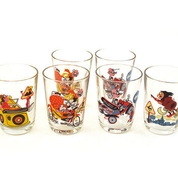Vintage set of six small glasses with bright colourful print. Made in France. Seventies.