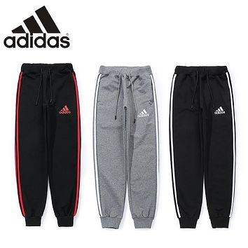 ADIDAS winter trend men and women three bars casual pants