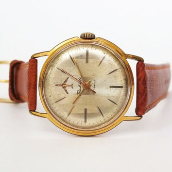Rare vintage mens watch RAKETA 60s 21 jewels, gilded wristwatch with plane