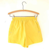 Vintage 80s bright yellow shorts. elastic waist shorts.