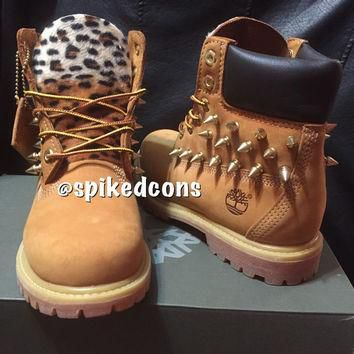 Youth/Women leopard spiked or no spikes timberlands Sizes 3.5-7 (fits women 5-9 also)