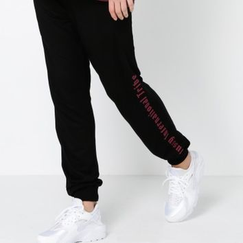 Stussy Text Velour Skinny Track Pants in Black with Red Stripes