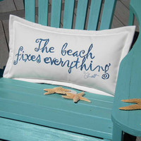 """The BEACH FIXES EVERYTHING  indoor outdoor pillow blue lettering on white background 12""""x20"""" handpainted coastal tides Crabby Chris Original"""