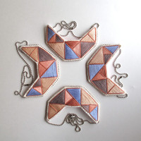 Small geometric bib necklace hand embroidered in soft tans rose lavender and taupe