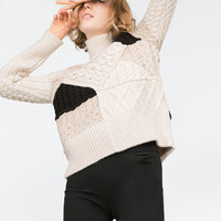 CABLE KNIT PATCHWORK SWEATER