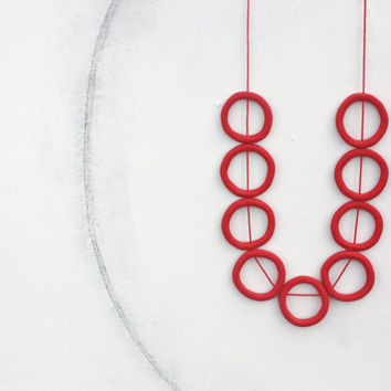Long red abstract minimal necklace, polymer clay circles wax cord
