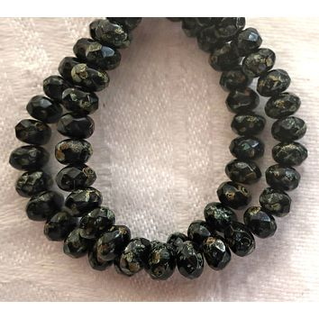 30 small Czech glass puffy rondelle beads - 3mm x 5mm - opaque jet black w/ a full picasso coat - faceted rondelles 5601