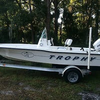 1997 17' Trophy Bayliner center console w/ 2013 90hp Evinrude E-tec and trailer