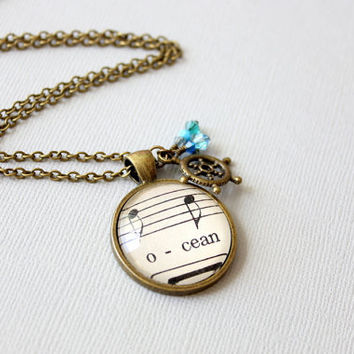 Nautical ocean necklace.  Sheet music pendant with ship wheel and blue crystals in vintage style setting