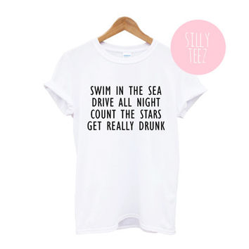 swim in the sea drive all night count the stars get really drunk tshirt white black loose tumblr internet fashion funny statement text