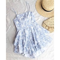 flower power ruffled romper in steel blue