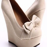 NUDE FAUX SUEDE BOW ACCENT WEDGES
