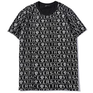 Versace 2019 new full printed logo men and women models round neck loose T-shirt Black