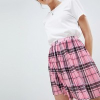 ASOS DESIGN pleated mini skirt in pink check at asos.com