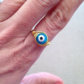 Turquoise and gold evil eye wire wrapped ring