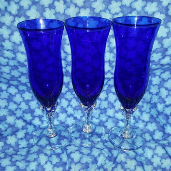 A Set Three Vintage Hand Blown Royal Blue Italian Champagne Flutes With Clear Stems, Glass Italian Art Glass Twisted Stems Blue Barware ,