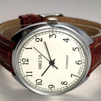 "LARGE Vintage men's watch "" Raketa "" (eng.Rocket).Russian mechanical watch with white-off dial.Comes with new quality leather band!"