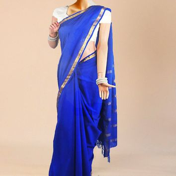 the classic blue pure crepe silk saree with subtle gold trim and threaded tail