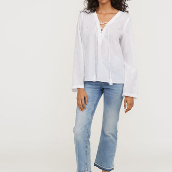 H&M Blouse with Eyelet Embroidery $29.99