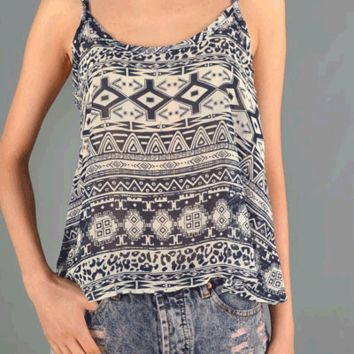 Take your look to wild heights with the Inner Tribal Woven Tank Top. This semi-sheer sleeveless top features a round neckline, tribal print throughout, chiffon construction, and thin shoulder straps design.