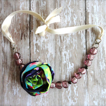 Bridal Purple, Green, and Teal Patterned Fabric Flower Necklace with Pink glass beads and Cream Satin Ribbon Tie.